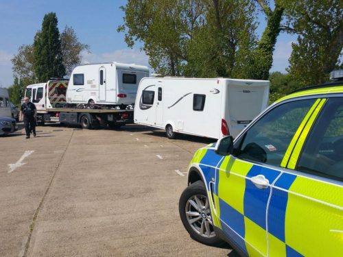 Police with caravan on truck